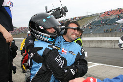 Andretti Green Racing crew members celebrate as Danica Patrick wins the Indy Japan 300