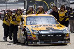 The DeWALT Ford Fusion is pushed thru the garage
