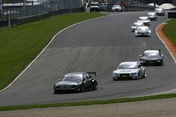 Paul di Resta, Team HWA AMG Mercedes, AMG Mercedes C-Klasse leads Tom Kristensen, Audi Sport Team Abt Audi A4 DTM 2008 and Timo Scheider, Audi Sport Team Abt, Audi A4 DTM