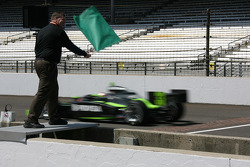 Honorary Starter Indianapolis Mayor Steve Ballard waives the green flag to open track action