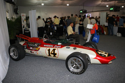 Fans seeking shelter from the rain look at the historical cars at Indianapolis Motor Speedway