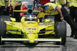 A crew member adjust Ed Carpenter's car before he qualifies