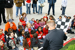 A group of children look at the checkered flag before practice starts