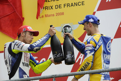 Podium: race winner Valentino Rossi celebrates with Colin Edwards