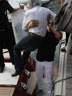 Jean Alesi, Lifts Bernie Ecclestone, President and CEO of Formula One Management onto a boat