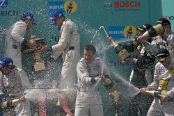 Podium: race winners #1 Manthey Racing Porsche 911 GT3 RSR: Timo Bernhard, Marc Lieb, Romain Dumas, Marcel Tiemann celebrates with champagne