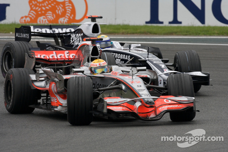 Lewis Hamilton, McLaren Mercedes, passes Nico Rosberg, WilliamsF1 Team