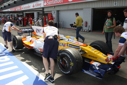Fernando Alonso, Renault F1 Team, R28, returns to the pits after stopping on track