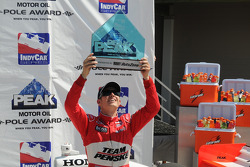 Ryan Briscoe raises his pole trophy triumphantly