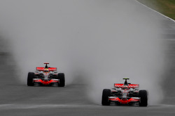 Heikki Kovalainen, McLaren Mercedes, MP4-23 leads Lewis Hamilton, McLaren Mercedes, MP4-23