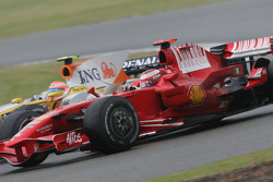 Nelson A. Piquet, Renault F1 Team, R28 and Kimi Raikkonen, Scuderia Ferrari, F2008