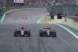 Romain Grosjean, Lotus F1 Team and Max Verstappen, Scuderia Toro Rosso