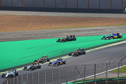 Fernando Alonso, McLaren MP4-30 and Marcus Ericsson, Sauber C34 run wide at the start of the race