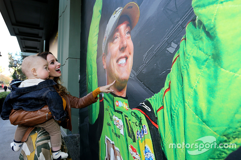 Samantha Busch and son Brexton look at a photo of 2015 NASCAR Sprint Cup Series champion Kyle Busch,