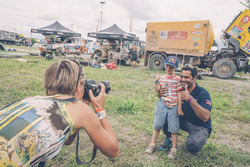 Nasser Al-Attiyah with a young fan