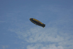 The Goodyear Blimp floats high overhead
