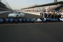 Jimmie Johnson and his team kiss the bricks
