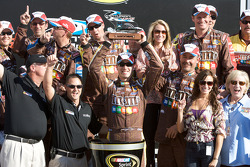 Victory lane: race winner Kyle Busch accepts the winner's trophy