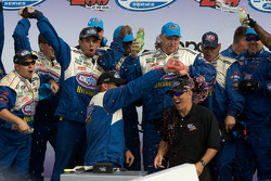 Victory lane: STP Ford crew members celebrate