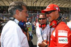 Dr. Mario Theissen, BMW Sauber F1 Team, BMW Motorsport Director talks with Michael Schumacher, Test Driver, Scuderia Ferrari