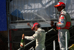 Podium: Lewis Hamilton and Robert Kubica celebrate with champagne