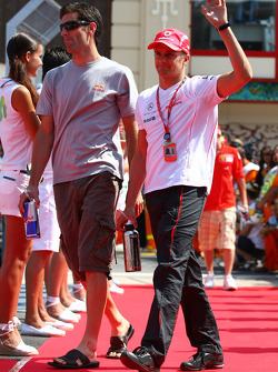Mark Webber, Red Bull Racing and Heikki Kovalainen, McLaren Mercedes