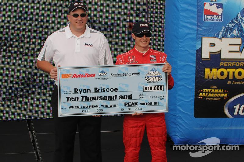 Ryan Briscoe accepts his pole check