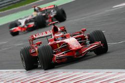 Kimi Raikkonen, Scuderia Ferrari, F2008 leads Lewis Hamilton, McLaren Mercedes