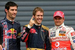 Polesitter Sebastian Vettel, tweede plaats Heikki Kovalainen, derde plaats Mark Webber