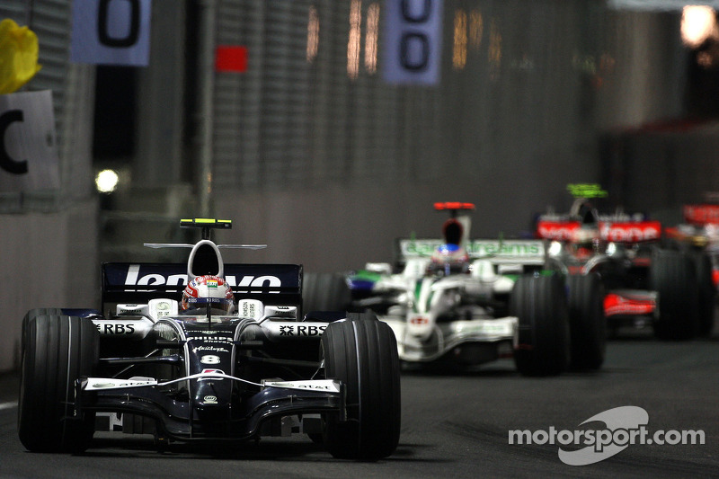 Kazuki Nakajima, Williams F1 Team, FW30 leads Jenson Button, Honda Racing F1 Team, RA108