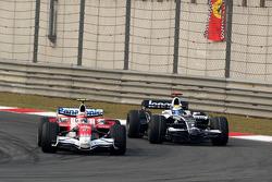 Timo Glock, Toyota F1 Team, TF108 leads Nico Rosberg, WilliamsF1 Team