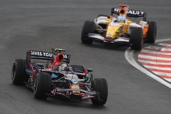 Sebastian Vettel, Scuderia Toro Rosso, STR03 and Fernando Alonso, Renault F1 Team, R28