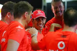 2008 World Champion Lewis Hamilton celebrates with McLaren Mercedes team members