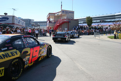 Crowds line the pit lane to the track during NASCAR Sprint Cup Series practice