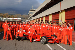 Valentino Rossi pose with the Ferrari F2008 and Ferrari team members