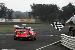 Jamie Whincup crosses the finish line to complete his 2008 V8 Supercar championship season