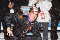 Victory lane: race winner James Buescher celebrates