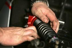 A Fisichella Motor Sport International mechanic at work