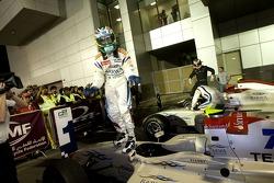 Race winner Sergio Perez celebrates