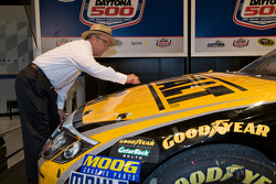 Champion's breakfast: Jack Roush, Roush Fenway Racing Ford owner, signs his 2009 Daytona 500 winning car