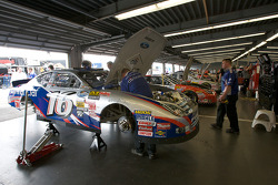 Crew member for Greg Biffle at work in the engine bay