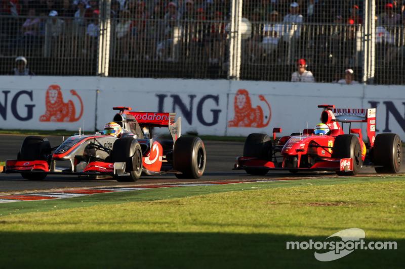 Lewis Hamilton, McLaren Mercedes, MP4-24 leads Felipe Massa, Scuderia Ferrari, F60