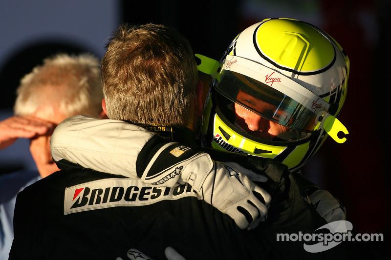 Jenson Button, Brawn GP, celebrates with Ross Brawn Brawn Grand Prix Team Principal
