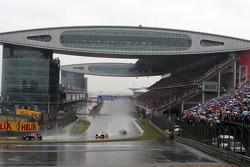Sebastian Vettel, Red Bull Racing leads Fernando Alonso, Renault F1 Team