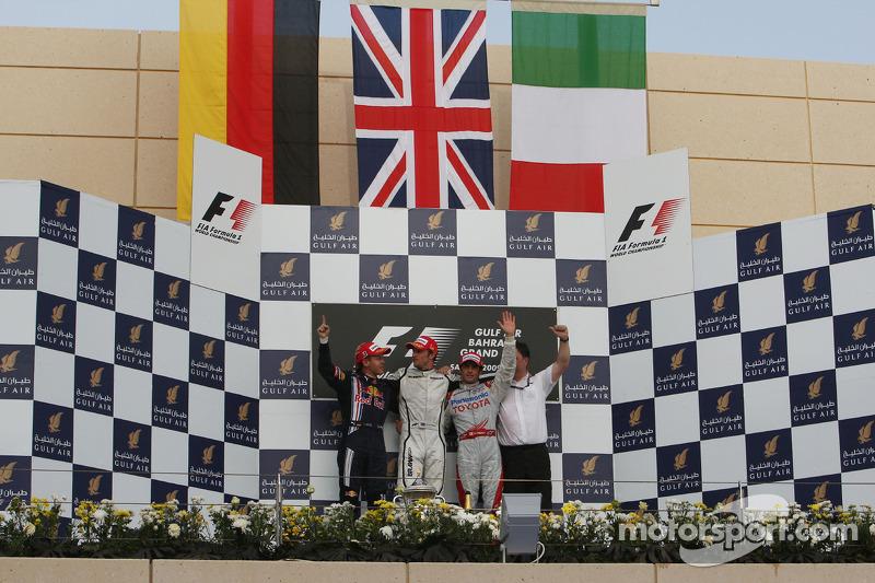 Podium: race winner Jenson Button, Brawn GP, second place Sebastian Vettel, Red Bull Racing, third place Jarno Trulli, Toyota Racing