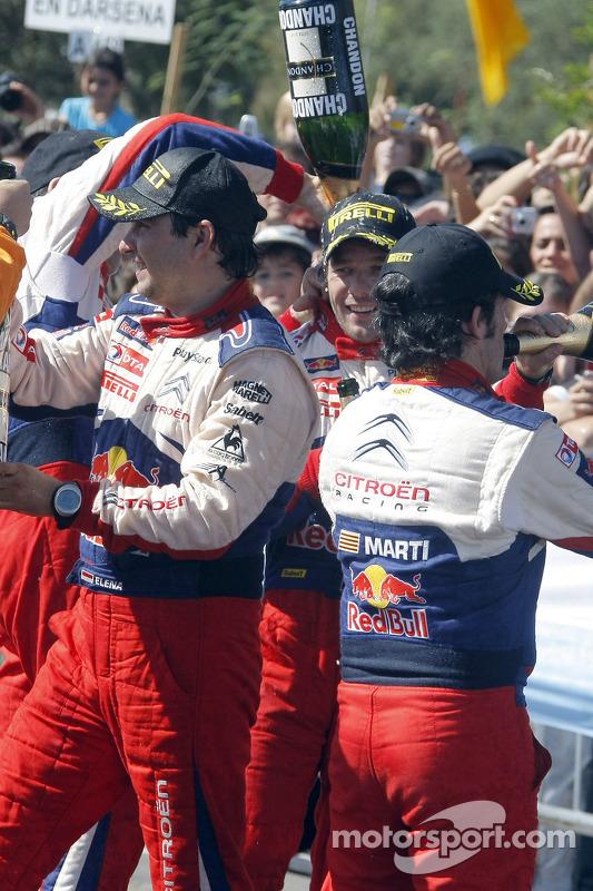 Podium: les vainqueurs Sébastien Loeb et Daniel Elena, Citroën C4, fêtent leur victoire au champagne