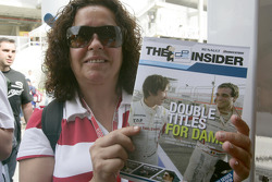 A fan with a copy of the GP2 Insider