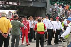 Scott Dixon and Chip Ganassi make their way down Gasoline Alley