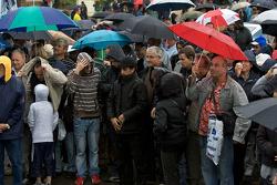Another rainstorm hits Le Mans as fans wait for the Team Peugeot Total Peugeot 908 cars to unload