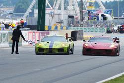 #83 Risi Competizione Ferrari F430 GT: Tracy Krohn, Nic Jonsson, Eric van de Poele, #82 Risi Competizione Ferrari F430 GT: Jaime Melo, Pierre Kaffer, Mika Salo cross the finish line